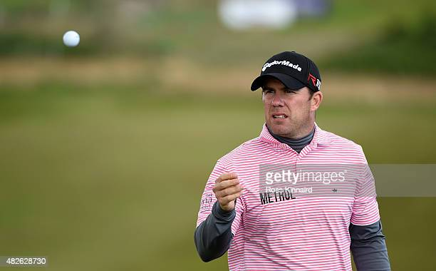Richie Ramsay of Scotland catches his ball on the 16th green in his match against Morten Orum Madsen of Denmark during the third round of the Saltire...