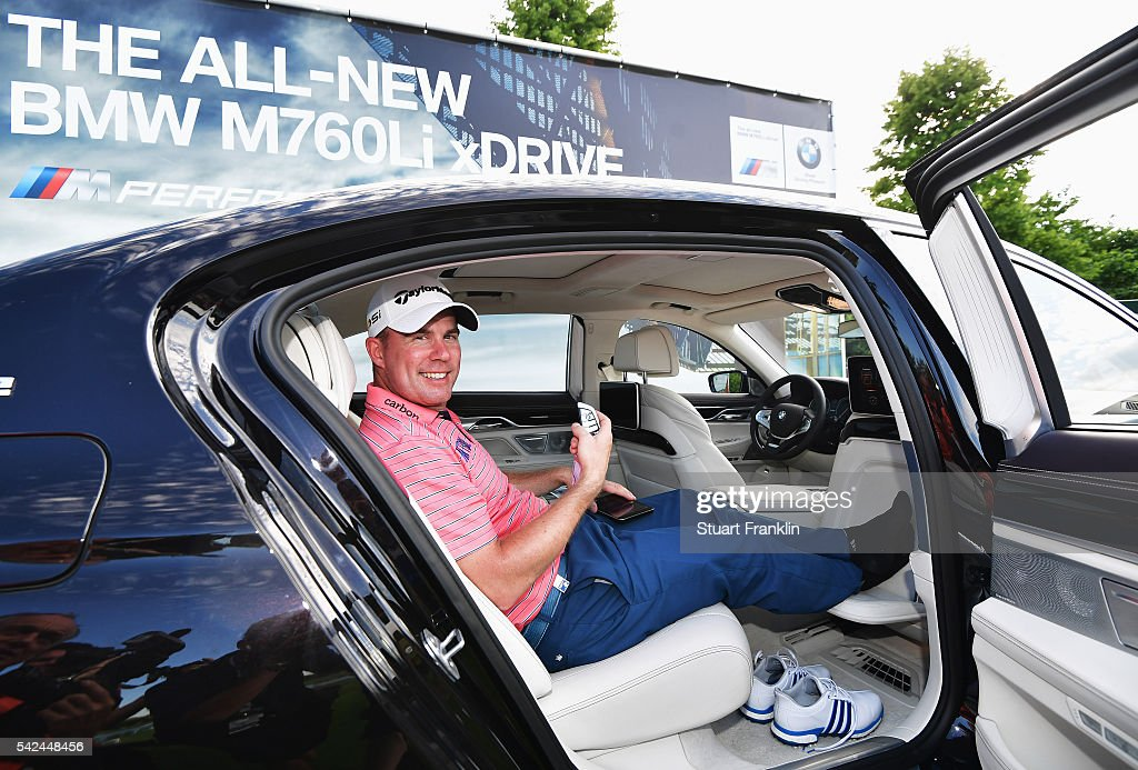 <a gi-track='captionPersonalityLinkClicked' href=/galleries/search?phrase=Richie+Ramsay&family=editorial&specificpeople=2286222 ng-click='$event.stopPropagation()'>Richie Ramsay</a> of Scotland celebrates after he won a BMW 760Li for making a hole in one on the 16th hole during the first round of the BMW International Open at Gut Larchenhof on June 23, 2016 in Cologne, Germany.