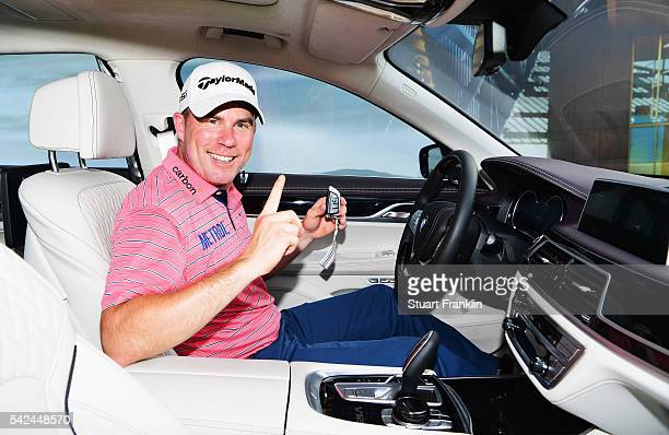 Richie Ramsay of Scotland celebrates after he won a BMW 760Li for making a hole in one on the 16th hole during the first round of the BMW...