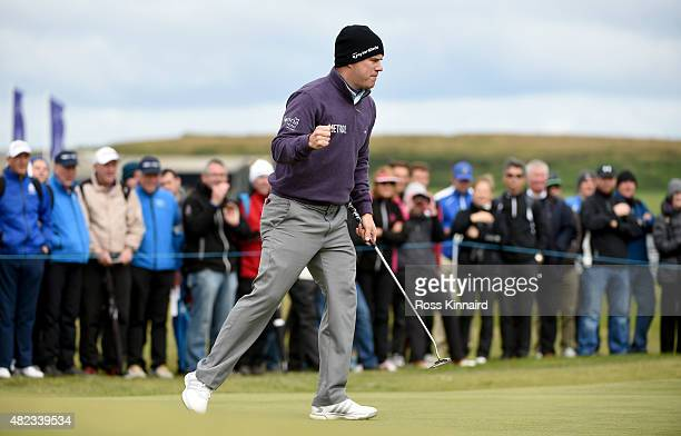 Richie Ramsay of Scotland celebrates after victory on the 18th green in his first round match against Shiv Kapur of India in the Saltire Energy Paul...