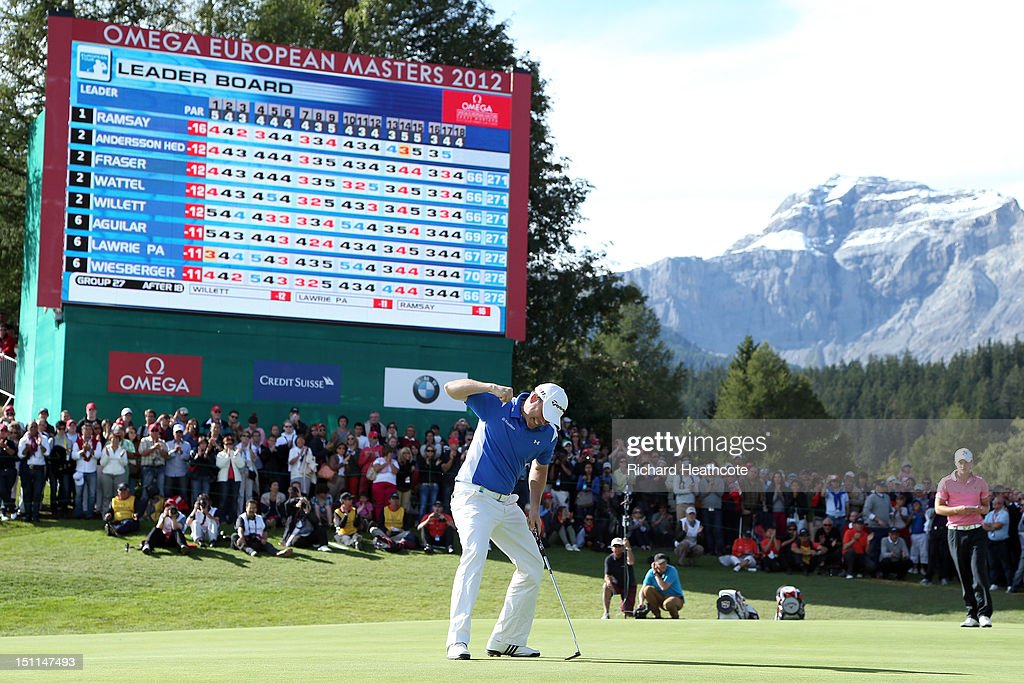 <a gi-track='captionPersonalityLinkClicked' href=/galleries/search?phrase=Richie+Ramsay&family=editorial&specificpeople=2286222 ng-click='$event.stopPropagation()'>Richie Ramsay</a> of Scotland celebrates as he holes the final putt on the 18th green to secure victory during final round of the Omega European Masters at Crans-sur-Sierre Golf Club on September 2, 2012 in Crans, Switzerland.