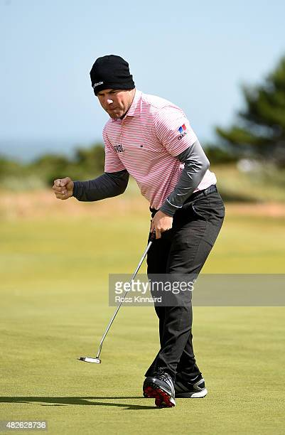 Richie Ramsay of Scotland celebrates on the 18th green in his match against Morten Orum Madsen of Denmark during the third round of the Saltire...