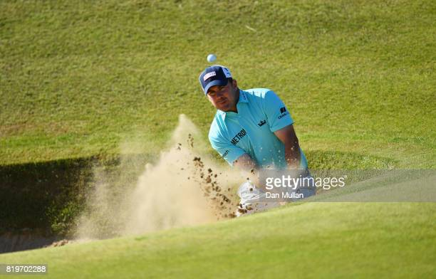 Richie Ramsay of Scotland hits a bunker shot on the 17th hole during the first round of the 146th Open Championship at Royal Birkdale on July 20 2017...