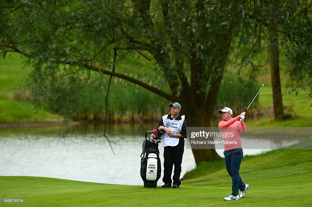 <a gi-track='captionPersonalityLinkClicked' href=/galleries/search?phrase=Richie+Ramsay&family=editorial&specificpeople=2286222 ng-click='$event.stopPropagation()'>Richie Ramsay</a> of Scotland hits his 2nd shot on the 15th hole during the first round of the 100th Open de France at Le Golf National on June 30, 2016 in Paris, France.