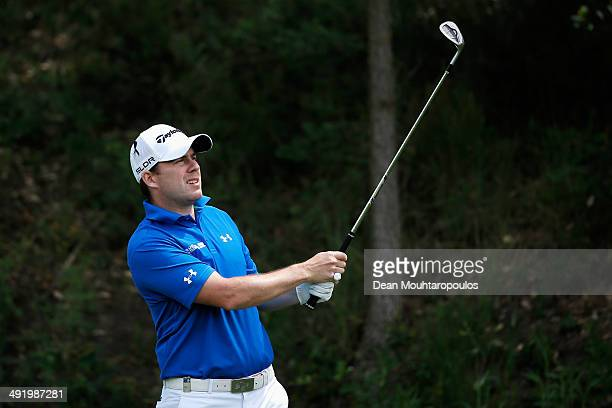 Richie Ramsay of Scotland hits his second shot on the 1st hole during the final round of the Open de Espana held at PGA Catalunya Resort on May 18...