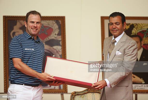 Richie Ramsay of Scotland is presented with his winner's trophy by HRH Prince Moulay Rachid of Morocco after the final round of the Trophee Hassan II...