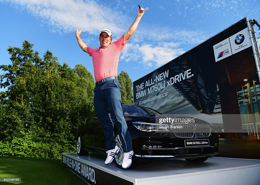 <a gi-track='captionPersonalityLinkClicked' href=/galleries/search?phrase=Richie+Ramsay&family=editorial&specificpeople=2286222 ng-click='$event.stopPropagation()'>Richie Ramsay</a> of Scotland jumps for joy after he won a BMW 760Li for making a hole in one on the 16th hole during the first round of the BMW International Open at Gut Larchenhof on June 23, 2016 in Cologne, Germany.
