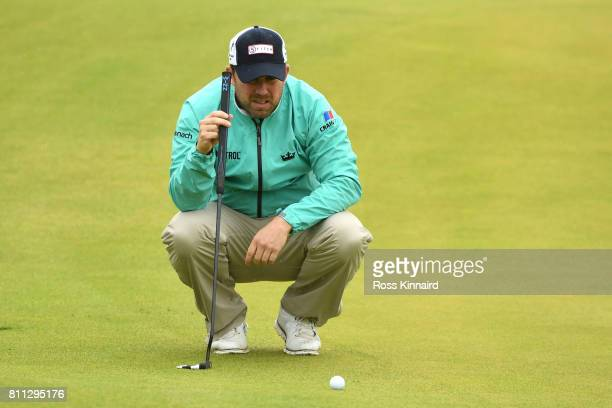 Richie Ramsay of Scotland lines up a putt on the 18th green during the final round of the Dubai Duty Free Irish Open at Portstewart Golf Club on July...