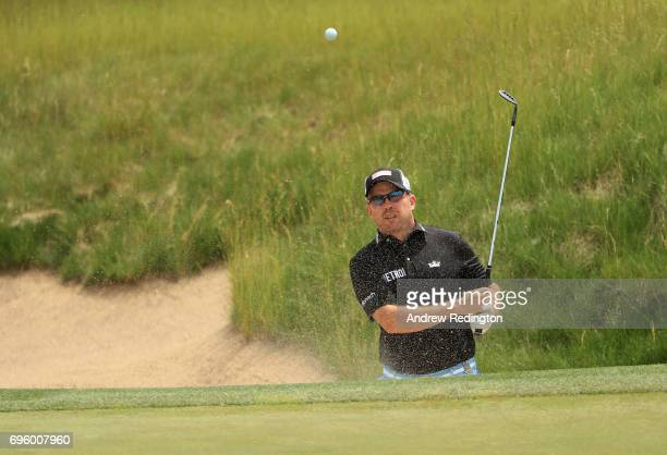 Richie Ramsay of Scotland plays his shot from the bunker during a practice round prior to the 2017 US Open at Erin Hills on June 14 2017 in Hartford...