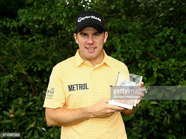 Richie Ramsay of Scotland poses with his European Tour Golfer of the Month award for March during day 2 of the BMW PGA Championship at Wentworth on...