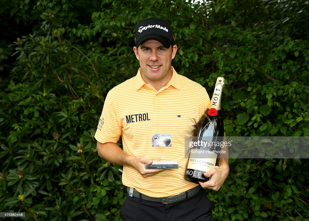 <a gi-track='captionPersonalityLinkClicked' href=/galleries/search?phrase=Richie+Ramsay&family=editorial&specificpeople=2286222 ng-click='$event.stopPropagation()'>Richie Ramsay</a> of Scotland poses with his European Tour Golfer of the Month award for March during day 2 of the BMW PGA Championship at Wentworth on May 22, 2015 in Virginia Water, England.