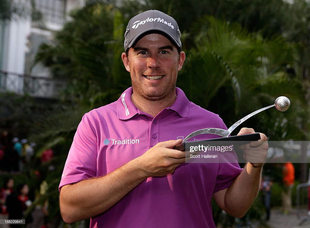 <a gi-track='captionPersonalityLinkClicked' href=/galleries/search?phrase=Richie+Ramsay&family=editorial&specificpeople=2286222 ng-click='$event.stopPropagation()'>Richie Ramsay</a> of Scotland poses with the September shot of the month award at the WGC HSBC Champions at the Mission Hills Resort on November 2, 2012 in Shenzhen, China.