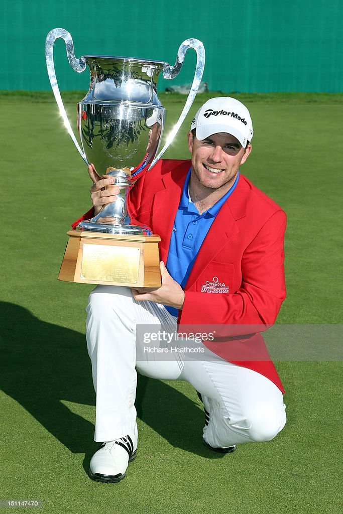 Richie Ramsay of Scotland poses with the trophy after victory in the final round of the Omega European Masters at Crans-sur-Sierre Golf Club on September 2, 2012 in Crans, Switzerland.