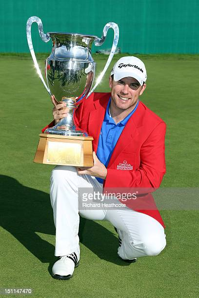 Richie Ramsay of Scotland poses with the trophy after victory in the final round of the Omega European Masters at CranssurSierre Golf Club on...