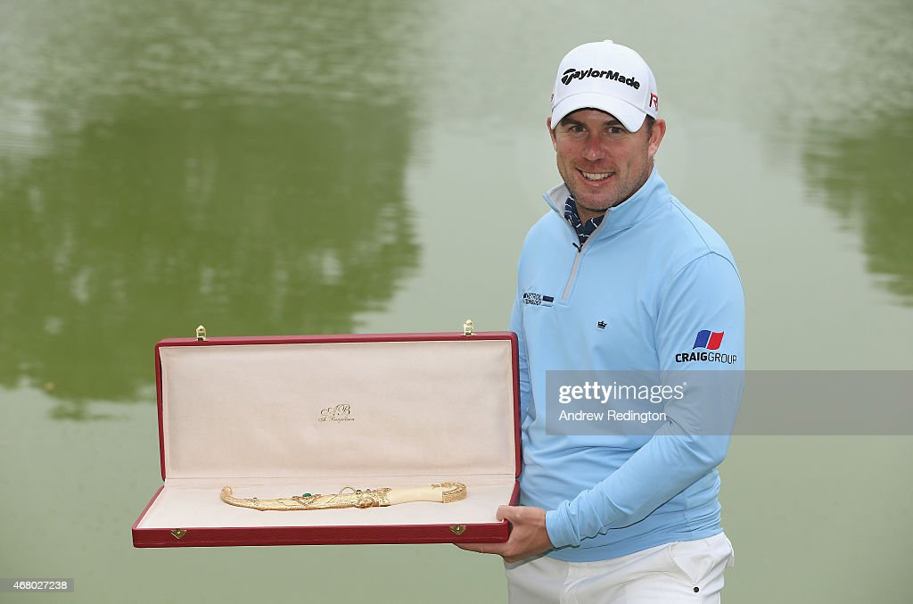 <a gi-track='captionPersonalityLinkClicked' href=/galleries/search?phrase=Richie+Ramsay&family=editorial&specificpeople=2286222 ng-click='$event.stopPropagation()'>Richie Ramsay</a> of Scotland poses with the trophy after winning the Trophee Hassan II Golf at Golf du Palais Royal on March 29, 2015 in Agadir, Morocco.