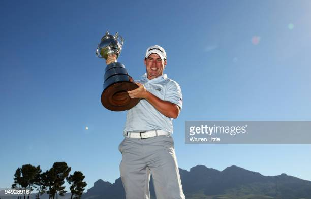 Richie Ramsay of Scotland poses with the trophy after winning the South African Open Championship after a playoff against Shiv Kapur of India at...