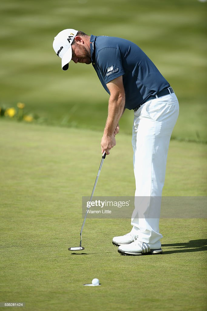 <a gi-track='captionPersonalityLinkClicked' href=/galleries/search?phrase=Richie+Ramsay&family=editorial&specificpeople=2286222 ng-click='$event.stopPropagation()'>Richie Ramsay</a> of Scotland putts on the 18th hole during day four of the BMW PGA Championship at Wentworth on May 29, 2016 in Virginia Water, England.