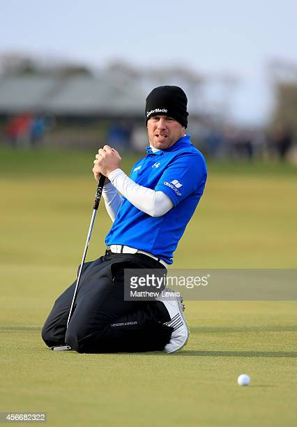 Richie Ramsay of Scotland reacts after missing his putt on the 17th green during the final round of the 2014 Alfred Dunhill Links Championship at The...