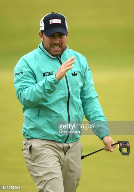 Richie Ramsay of Scotland reacts to a putt on the 18th green during the final round of the Dubai Duty Free Irish Open at Portstewart Golf Club on...