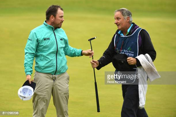 Richie Ramsay of Scotland reacts with his caddie on the 18th green during the final round of the Dubai Duty Free Irish Open at Portstewart Golf Club...