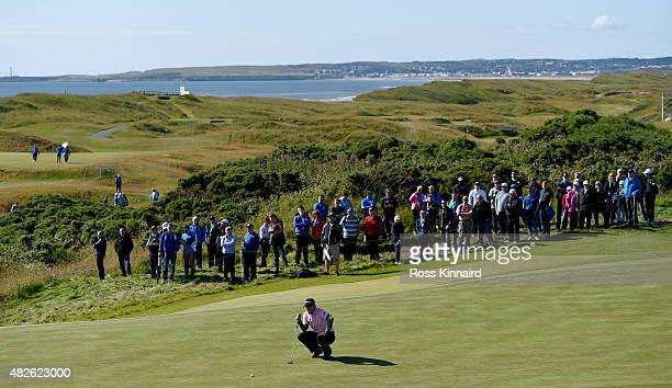 Richie Ramsay of Scotland waits to putt on the 5th green in his match against Morten Orum Madsen of Denmark during the third round of the Saltire...