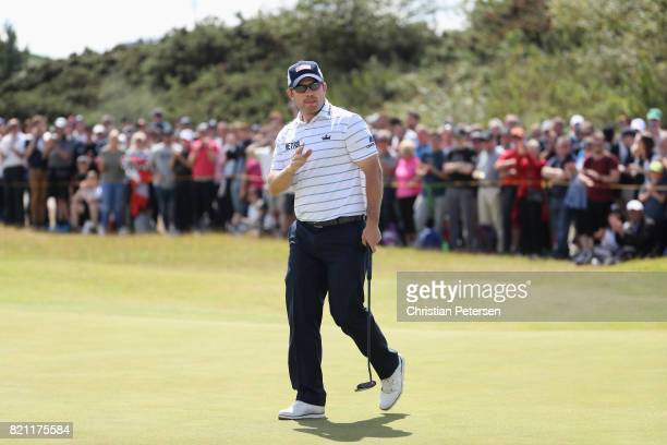 Richie Ramsay of Scotland waves to the crowd after a birdie on the 1st hole during the final round of the 146th Open Championship at Royal Birkdale...