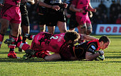 Richie Rees of the Dragons goes over for his side's first try during the LV= Cup match between Newport Gwent Dragons and London Welsh at Rodney...