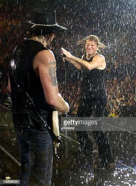 Richie Sambora and Jon Bon Jovi during Bon Jovi's 'Bounce Tour' Live at Giants Stadium on August 7 2003 Show at Giants Stadium in East Rutherford New...