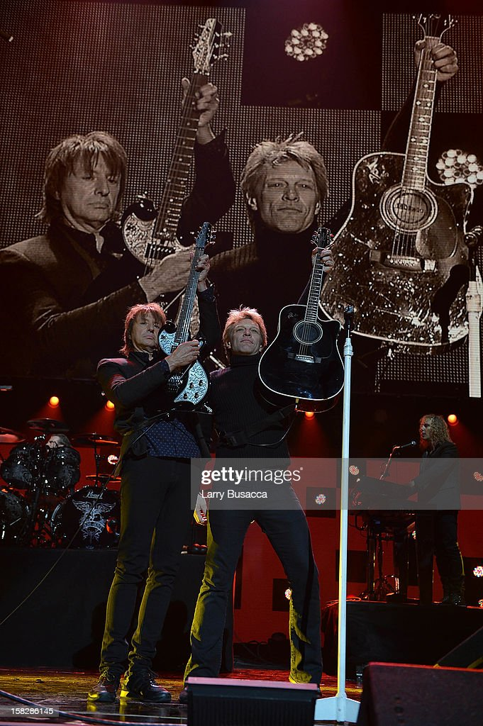 Richie Sambora and Jon Bon Jovi perform at '12-12-12' a concert benefiting The Robin Hood Relief Fund to aid the victims of Hurricane Sandy presented by Clear Channel Media & Entertainment, The Madison Square Garden Company and The Weinstein Company at Madison Square Garden on December 12, 2012 in New York City.