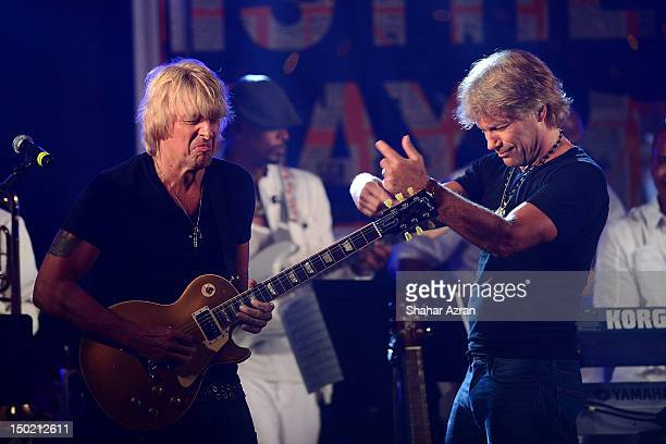 Richie Sambora and Jon Bon Jovi perform at Apollo In The Hamptons A Night Of Legends at The Creeks on August 11 2012 in East Hampton New York
