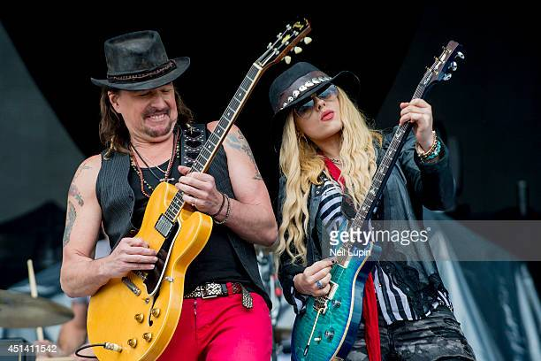 Richie Sambora and Orianthi perform on stage at Calling Festival at Clapham Common on June 28 2014 in London United Kingdom