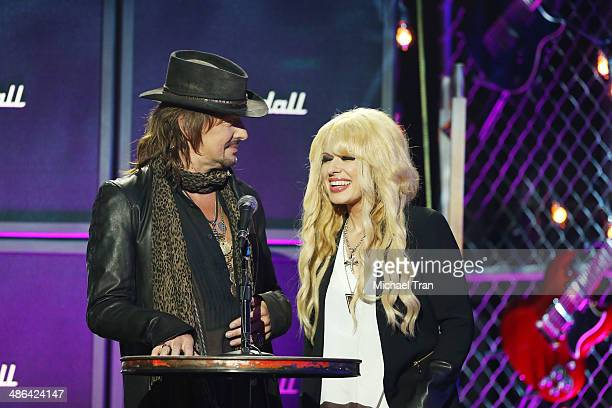Richie Sambora and Orianthi speak onstage during the 6th Annual Revolver Golden Gods Award Show held at Club Nokia on April 23 2014 in Los Angeles...