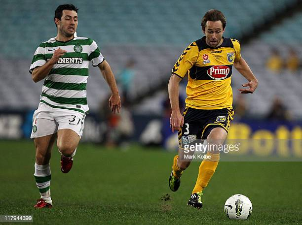 Richie Towell of Celtic and Josh Rose of the Mariners compete for the ball during the international friendly club match between the Central Coast...