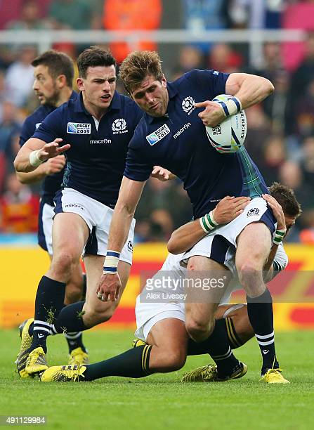 Richie Vernon of Scotland is tackled by Handre Pollard of South Africa during the 2015 Rugby World Cup Pool B match between South Africa and Scotland...