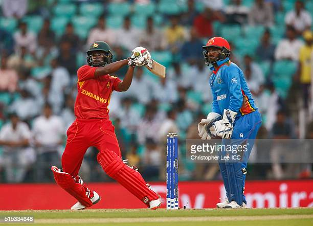 Richmond Mutumbami of Zimbabwe in action with Mohammad Shahzad of Afghanistan during the ICC Twenty20 World Cup Round 1 Group B match between...