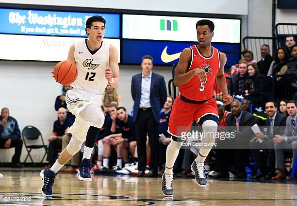 Richmond Spiders guard Nick Sherod chases after George Washington Colonials guard Yuta Watanabe during an Atlantic 10 men's basketball on January 08...