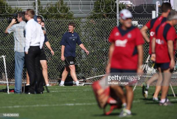Richmond Tigers coach Damien Hardwick walks by during a Melbourne Demons AFL training session at Gosch's Paddock on March 26 2013 in Melbourne...