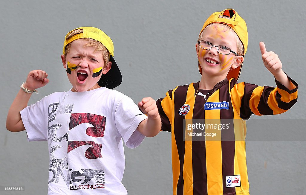 A Richmond Tigers fan and a Hawthorn Hawks fan show their support during the round three NAB Cup AFL match between the Hawthorn Hawks and the Richmond Tigers at Aurora Stadium on March 9, 2013 in Launceston, Australia.