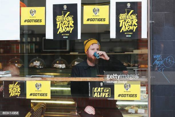 Richmond Tigers fan enjoys an espresso at a Richmond Cafe on Swan Street on September 25 2017 in Melbourne Australia The Richmond Tigers will play...
