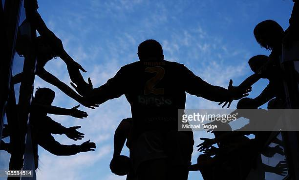 Richmond Tigers fans greet Dylan Grimes of the Tigers before the warm up during the round two AFL match between the St Kilda Saints and the Richmond...