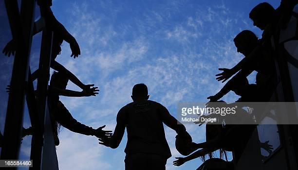 Richmond Tigers fans greet Jack Riewoldt of the Tigers before the warm up during the round two AFL match between the St Kilda Saints and the Richmond...