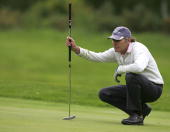 Rick Adams lines up a putt on 17th hole during the Senior PGA Professional Championship at The Northants County Golf Club on May 28 2009 in...