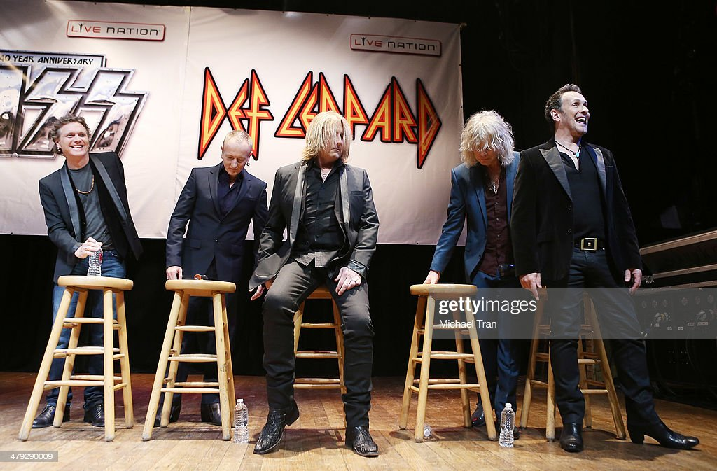 Rick Allen, Phil Collen, Joe Elliott, Rick Savage and Vivian Campbell of Def Leppard attend the announcment of their 2014 Summer tour held at The House of Blues on Sunset on March 17, 2014 in Los Angeles, California.