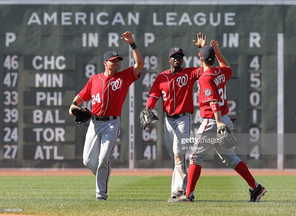 Rick Ankiel #24, Bryce Harper #34, and Roger Bernadina #2 of the Washington Nationals celebrate a 4-3 win over the Boston Red Sox during interleague play at Fenway Park June 10, 2012 in Boston, Massachusetts.