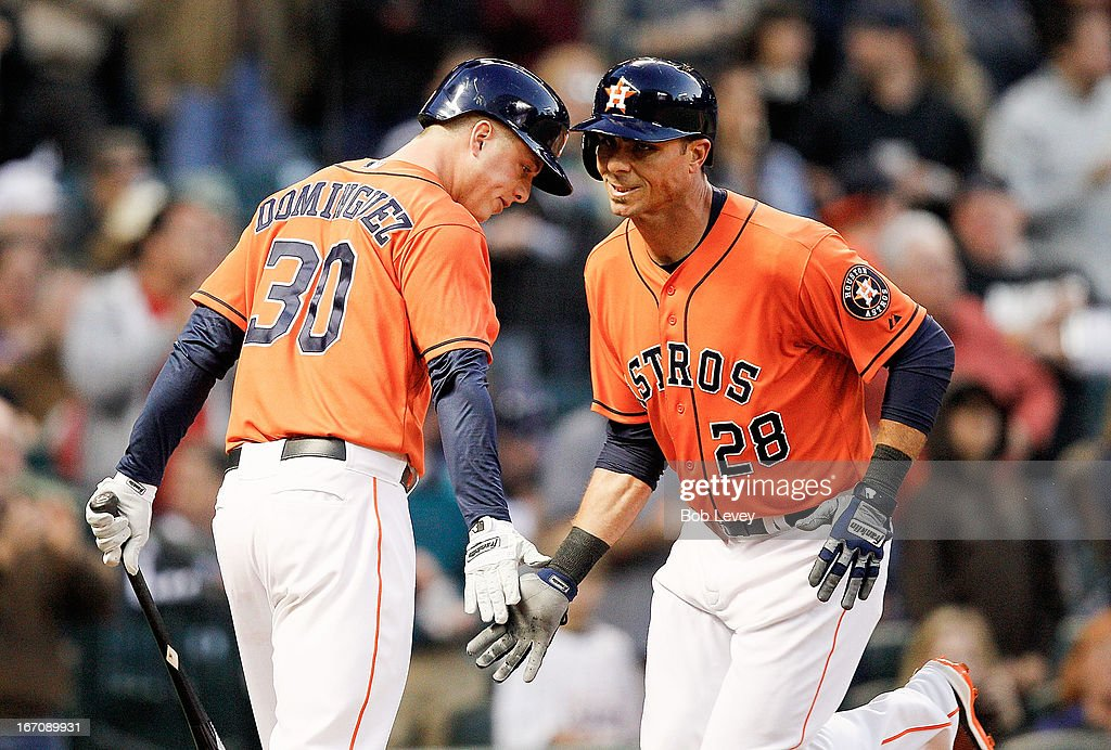 <a gi-track='captionPersonalityLinkClicked' href=/galleries/search?phrase=Rick+Ankiel&family=editorial&specificpeople=803371 ng-click='$event.stopPropagation()'>Rick Ankiel</a> #28 of the Houston Astros receives congratulations from Matt Dominguez #30 after hitting a home run in the second inning against the Cleveland Indians at Minute Maid Park on April 19, 2013 in Houston, Texas.
