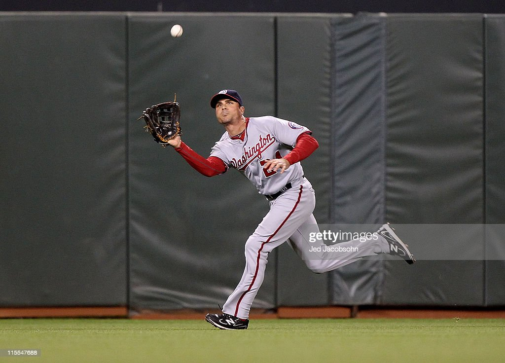 <a gi-track='captionPersonalityLinkClicked' href=/galleries/search?phrase=Rick+Ankiel&family=editorial&specificpeople=803371 ng-click='$event.stopPropagation()'>Rick Ankiel</a> #24 of the Washington Nationals catches a ball hit by Aaron Rowand of the San Francisco Giants during an MLB game at AT&T Park on June 7, 2011 in San Francisco, California.
