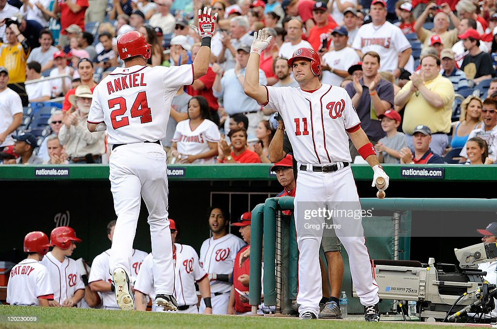 <a gi-track='captionPersonalityLinkClicked' href=/galleries/search?phrase=Rick+Ankiel&family=editorial&specificpeople=803371 ng-click='$event.stopPropagation()'>Rick Ankiel</a> #24 of the Washington Nationals celebrates with <a gi-track='captionPersonalityLinkClicked' href=/galleries/search?phrase=Ryan+Zimmerman+-+Baseball+Player&family=editorial&specificpeople=534809 ng-click='$event.stopPropagation()'>Ryan Zimmerman</a> #11 after hitting a home run in the first inning against the Atlanta Braves at Nationals Park on August 1, 2011 in Washington, DC.
