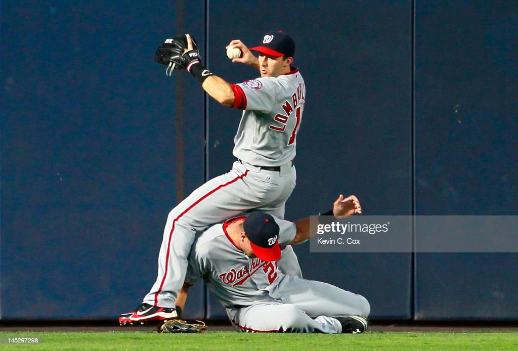 <a gi-track='captionPersonalityLinkClicked' href=/galleries/search?phrase=Rick+Ankiel&family=editorial&specificpeople=803371 ng-click='$event.stopPropagation()'>Rick Ankiel</a> #24 of the Washington Nationals collides with Stephen Lombardozzi #1 in the third inning on a triple by Martin Prado #14 of the Atlanta Braves by at Turner Field on May 25, 2012 in Atlanta, Georgia.