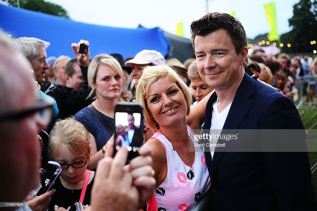 <a gi-track='captionPersonalityLinkClicked' href=/galleries/search?phrase=Rick+Astley&family=editorial&specificpeople=1182850 ng-click='$event.stopPropagation()'>Rick Astley</a> signs autographs for fans on Day 2 of Rewind 80s Festival 2013 at Scone Palace on July 27, 2013 in Perth, Scotland.