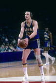 Rick Barry of the Golden State Warriors is at the freethrow line against the Washington Bullets during a circa 1974 NBA basketball game at the...